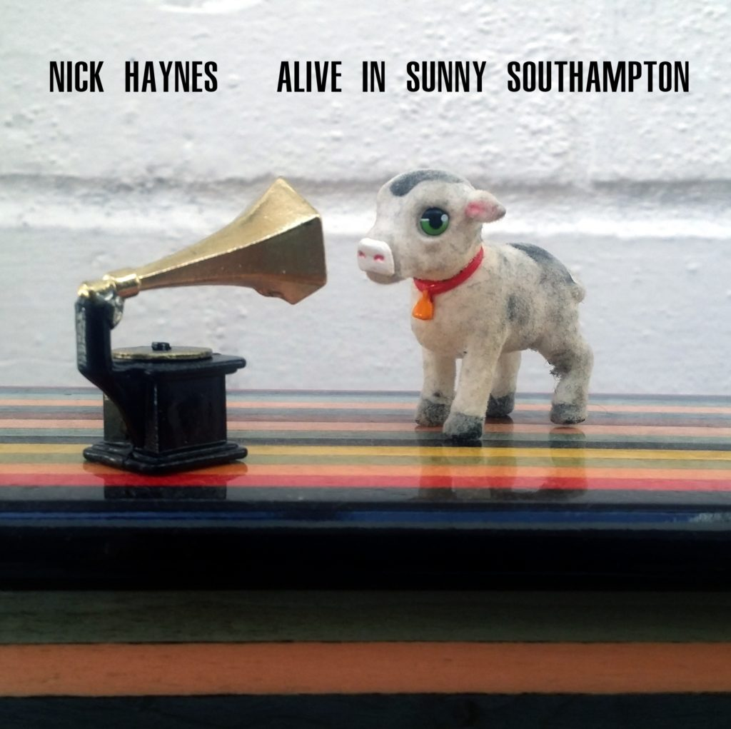 "Picture of Tiny Cow with old fashioned gramophone. Title reads ""Nick Haynes Alive in Sunny Southampton"""